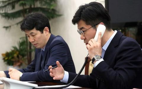 <span>An official talks on a phone for testing a hotline between the two Koreas at the Presidential Blue House in Seoul</span> <span>Credit: Reuters </span>
