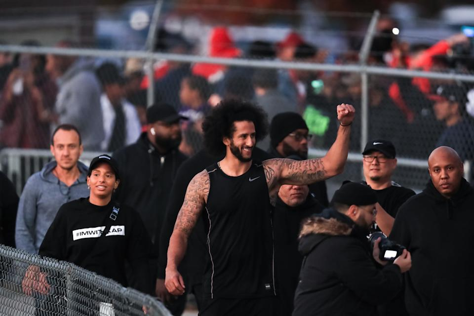 Colin Kaepernick visits with fans following his workout held at Drew High School on Saturday. (Carmen Mandato/Getty Images)