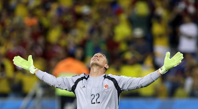 Colombia's goalkeeper Faryd Mondragon celebrates after Colombia's James Rodriguez scored his side's fourth goal during the group C World Cup soccer match between Japan and Colombia at the Arena Pantanal in Cuiaba, Brazil, Tuesday, June 24, 2014. (AP Photo/Kirsty Wigglesworth)