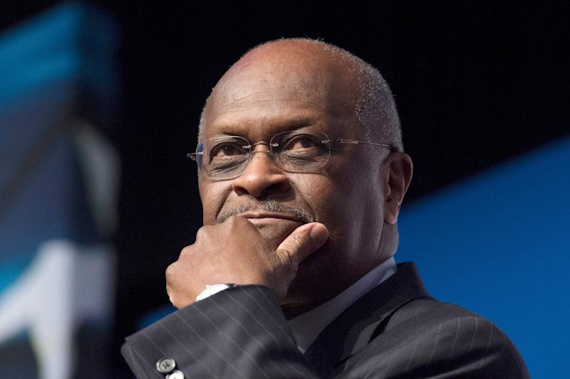 "FILE - In this June 20, 2014 file photo, Herman Cain, CEO, The New Voice, speaks during Faith and Freedom Coalition's Road to Majority event in Washington. President Donald Trump said Wednesday, April 10, 2019, that Cain is a ""wonderful man,"" but it will be up to him to decide whether to go forward with a nomination to the Federal Reserve's seven-member board. (AP Photo/Molly Riley, File)"