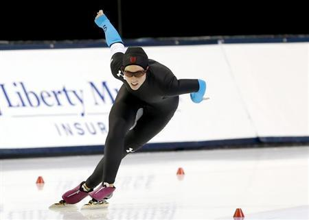 Dec 29, 2013; Kearns, UT, USA; Kelli Gunther competes in the 1000m during the U.S. Olympic speedskating trials at Utah Olympic Oval. Mandatory Credit: Chris Nicoll-USA TODAY Sports - RTX16WRE
