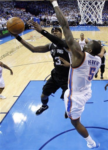 San Antonio Spurs guard Stephen Jackson (3) shoots against Oklahoma City Thunder center Kendrick Perkins (5) during the first half of Game 4 in the NBA basketball playoffs Western Conference finals, Saturday, June 2, 2012, in Oklahoma City. (AP Photo/Sue Ogrocki)