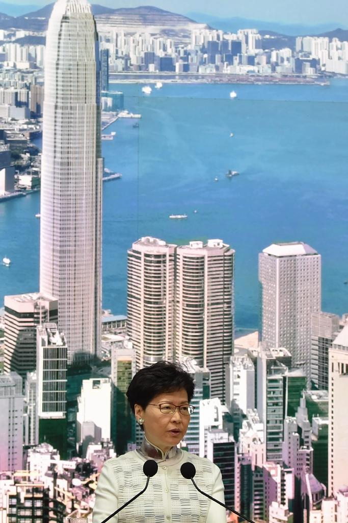 Experts say Hong Kong's beleaguered chief executive, Carrie Lam, would not have pushed the legislation without guidance from her backers in Beijing (AFP Photo/HECTOR RETAMAL)