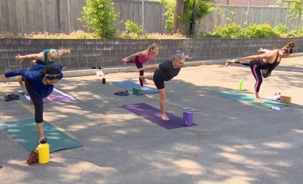 An in-person class at Power Yoga Mississauga this morning as some restrictions on outdoor fitness classes were lifted in Ontario as part of its reopening plan.  (Paul Smith/CBC - image credit)