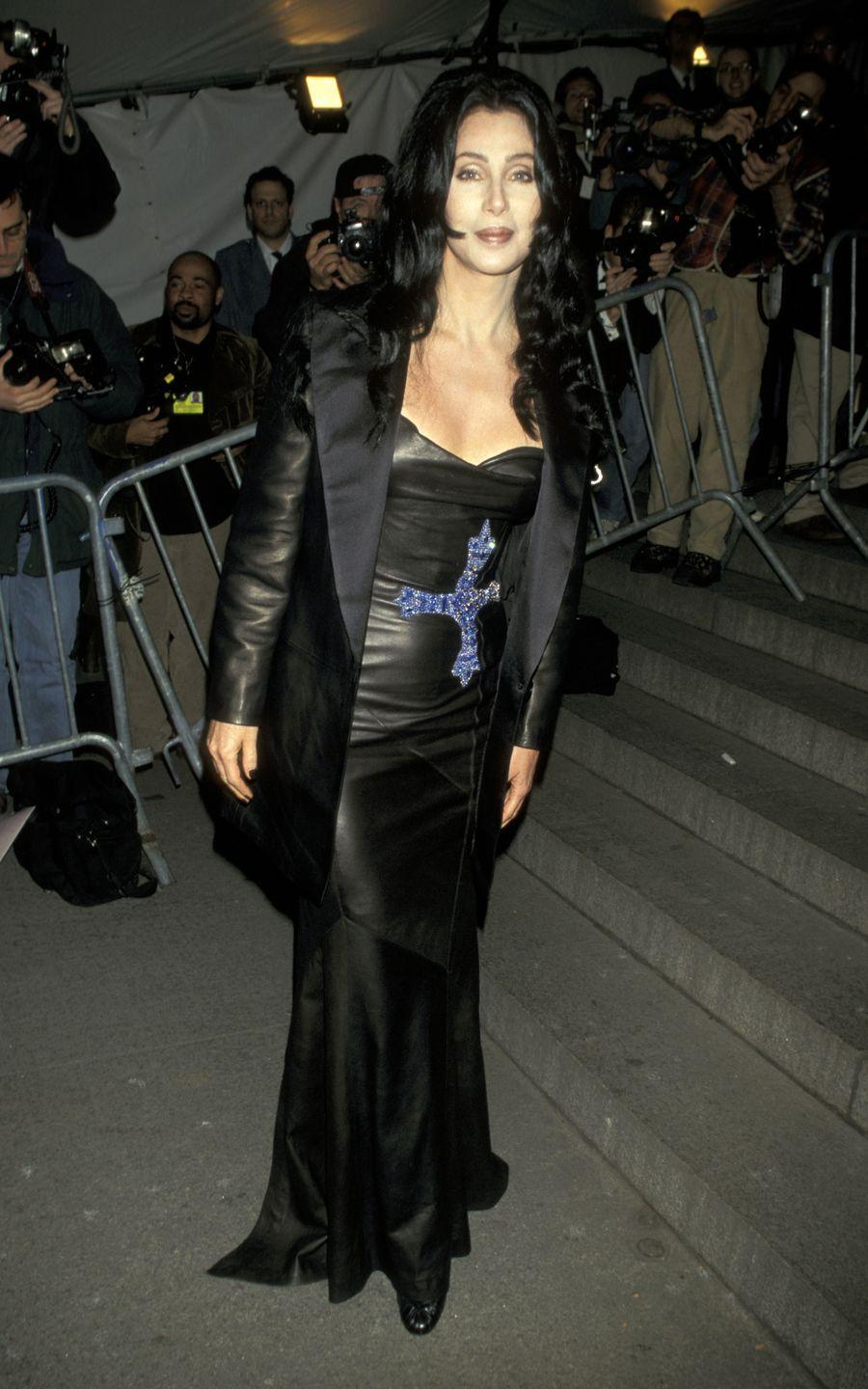 <p>In a leather gown and jacket at the 1997 Met Gala honoring Gianni Versace.</p>