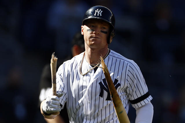 New York Yankees' Clint Frazier walks back to the dugout with a broken bat after striking out to end the ninth inning of a baseball game against the Kansas City Royals on Sunday, April 21, 2019, in New York. (AP Photo/Adam Hunger)
