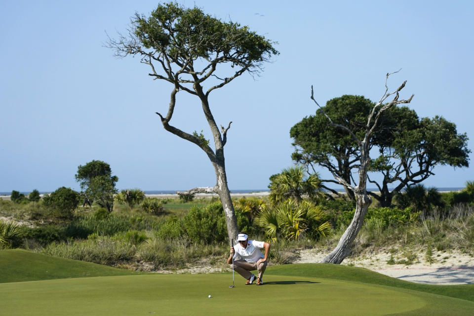 Ian Poulter, of England, lines up a putt on the second green during the second round of the PGA Championship golf tournament on the Ocean Course Friday, May 21, 2021, in Kiawah Island, S.C. (AP Photo/Matt York)