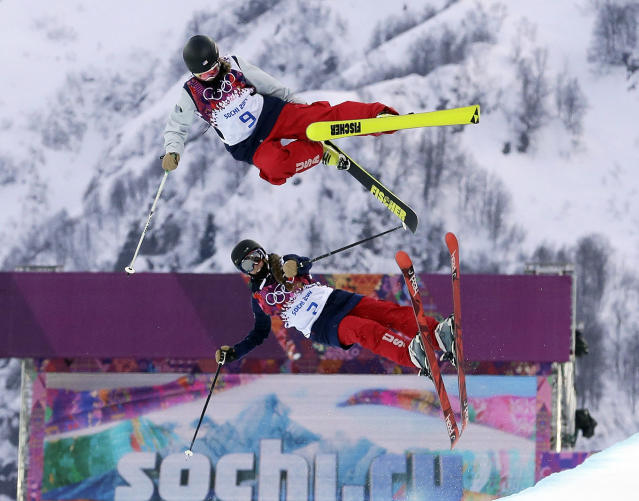 Annalisa Drew of the United States, top, and compatriot Maddie Bowman get air during training ahead of women's ski halfpipe qualifying at the at the Rosa Khutor Extreme Park, at the 2014 Winter Olympics, Thursday, Feb. 20, 2014, in Krasnaya Polyana, Russia. (AP Photo/Andy Wong)