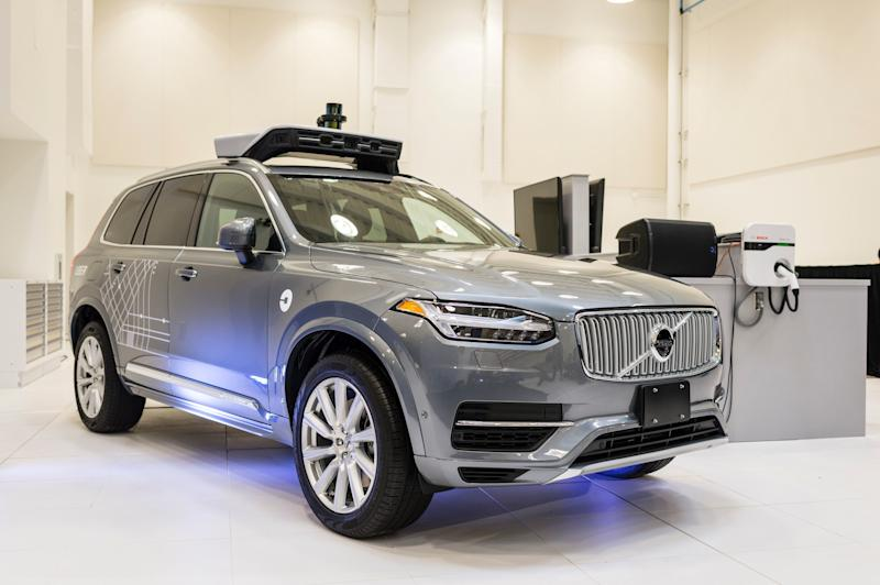 Uber's self-driving vehicles are topped with rotating sensors. This pilot model is displayed at the Uber Advanced Technologies Center in Pittsburgh in September2016.
