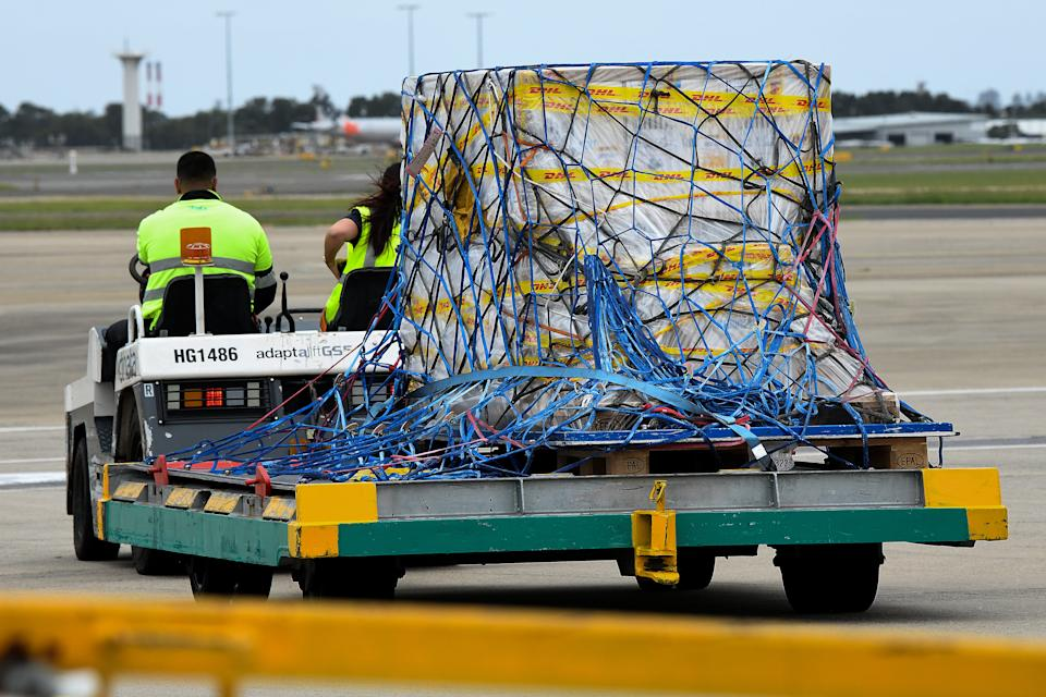 The first Australian shipment of Pfizer Covid-19 vaccines is seen being transported off the tarmac after landing at Sydney International Airport on Monday, February 15, 2021.