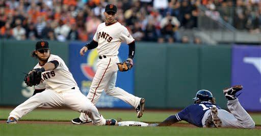 San Diego Padres' Chris Denorfia, right, steals second base past San Francisco Giants shortstop Brandon Crawford in the first inning of a baseball game, Saturday, Sept 22, 2012, in San Francisco. Backing up the play is Giants second baseman Marco Scutaro, center. (AP Photo/Ben Margot)