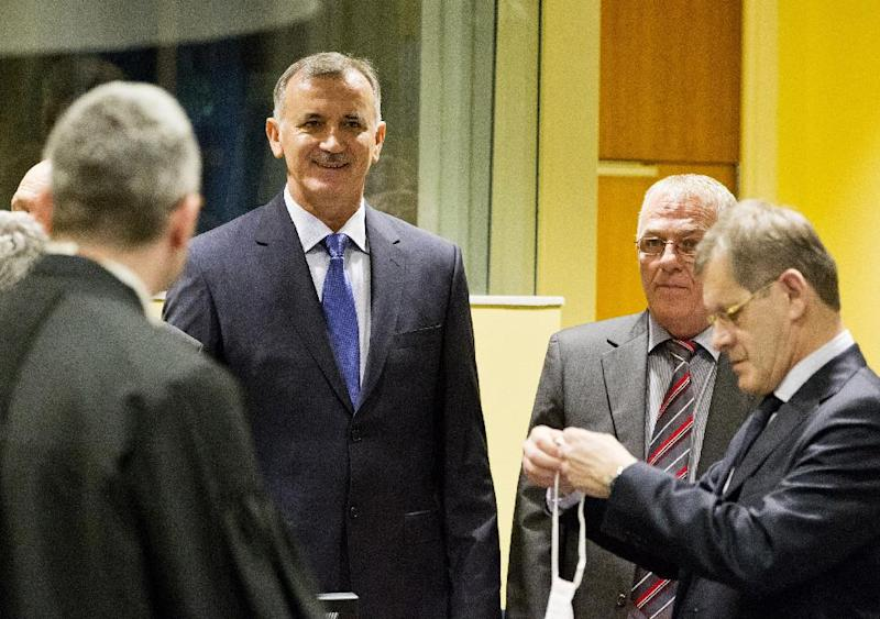 Bosnian Croat Valentin Coric, second left and Berislav Pusic, second right, arrive prior to their judgment at the Yugoslav war crimes tribunal (ICTY) in The Hague, Netherlands, Wednesday May 29, 2013. The ICTY delivers verdicts in the long-running trial of six senior Bosnian Croats on charges of crimes against Muslims and Serbs as they tried to carve out a Croat state in Bosnia during the country's 1992-95 war. Prosecutors have asked for sentences of up to 40 years for the suspects. (AP Photo/Jiri Buller, pool)