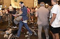<p>Juventus' fans run away from San Carlo Square following panic created by the explosion of firecrackers as they was watching the match on a giant screen on June 3, 2017. (Giorgio Perottino/Reuters) </p>