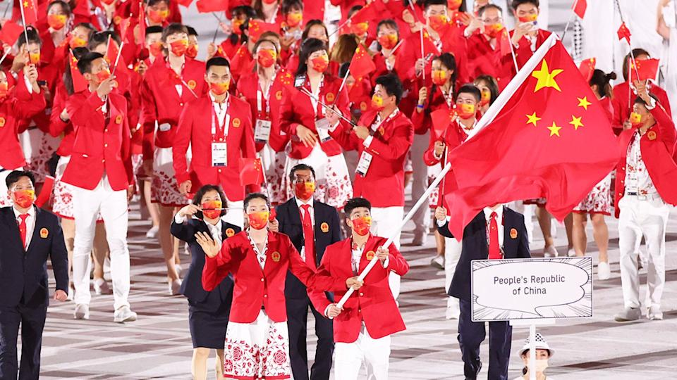 Pictured here, Team China at the opening ceremony for the Tokyo Games.