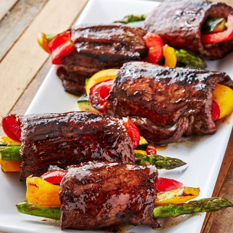 """<p>Balsamic glazed steaks get rolled around fresh veggies for the perfect combo. It's a fun appetiser or an easy summer dinner. Securing the roll-ups with toothpicks makes them MUCH easier to cook. Just don't forget to remove them when it's time for serving! </p><p>Get the <a href=""""https://www.delish.com/uk/cooking/recipes/a35261967/balsamic-steak-roll-ups-recipe/"""" rel=""""nofollow noopener"""" target=""""_blank"""" data-ylk=""""slk:Balsamic Steak Rolls-Ups"""" class=""""link rapid-noclick-resp"""">Balsamic Steak Rolls-Ups</a> recipe.</p>"""