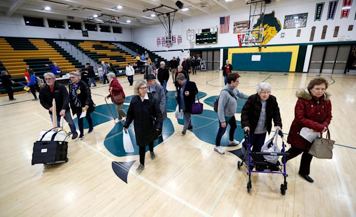 Des Moines, Iowa, residents enter a caucus site at Hoover High School on Monday. (Photo: Charlie Neibergall/ASSOCIATED PRESS)