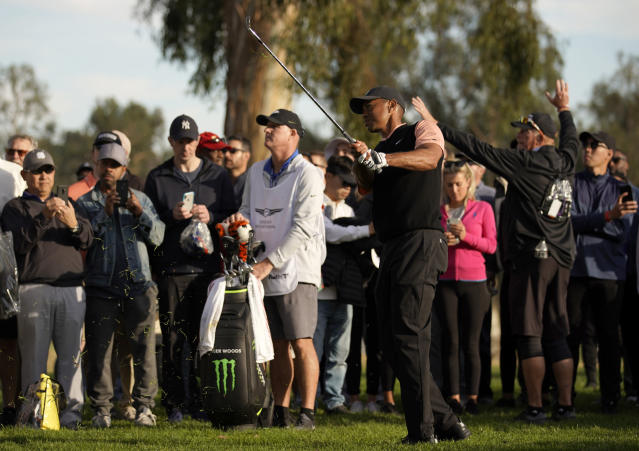 Tiger Woods hits out of the rough on the 18th hole during the first round of the Genesis Invitational golf tournament at Riviera Country Club, Thursday, Feb. 13, 2020, in the Pacific Palisades area of Los Angeles. (AP Photo/Ryan Kang)