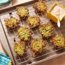 """<p>You may not think of crispy zucchini fritters when you think of Thanksgiving apps, but give them a try! They won't spoil your guests' appetites, and they're super delicious. </p><p><a href=""""https://www.thepioneerwoman.com/food-cooking/recipes/a36831775/zucchini-fritters-recipe/"""" rel=""""nofollow noopener"""" target=""""_blank"""" data-ylk=""""slk:Get the recipe."""" class=""""link rapid-noclick-resp""""><strong>Get the recipe.</strong></a></p>"""