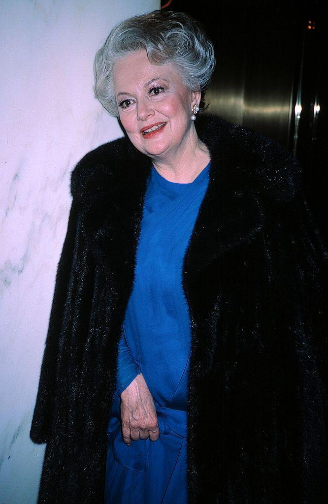 <p>Olivia chose a bright blue look for the Night of 100 Stars Benefit at the Hilton Hotel in 1985.</p>