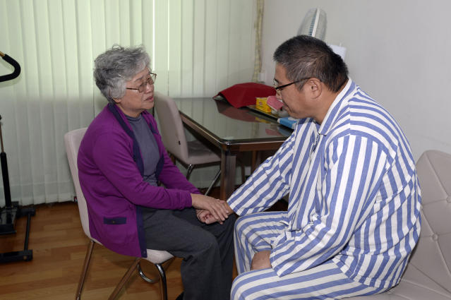 Kenneth Bae, right, an American man detained in North Korea for the past 11 months, and his mother Myunghee Bae talk each other during their meeting at a hospital in Pyongyang Friday, Oct. 11, 2013. For the first time since he was sentenced eleven months ago to 15 years of hard labor in North Korea, the Korean-American Christian missionary and tour operator has had a visit today from his mother. She later told Japan's Kyodo News agency that Kenneth Bae's health has gotten better since he was transferred to a hospital from a prison where he was serving his sentence. But he told her that his condition is still not good. (AP Photo/The Choson Sinbo, Mun Kwang Son) NO SALES, NO ARCHIVING, ONE TIME USE ONLY, CREDIT MANDATORY