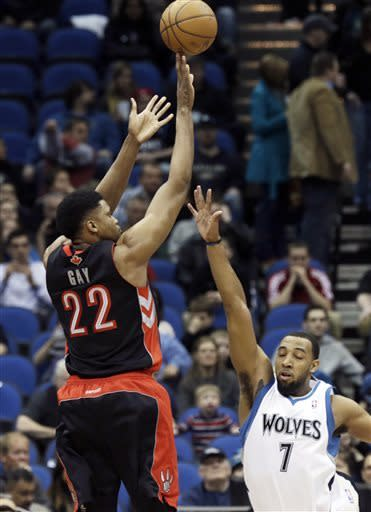 Toronto Raptors' Rudy Gay, left, shoots over Minnesota Timberwolves' Derrick Williams in the first quarter of an NBA basketball game, Friday, April 5, 2013, in Minneapolis. (AP Photo/Jim Mone)