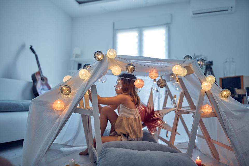 Build a den out of sheets and Christmas lights.(Getty Images)