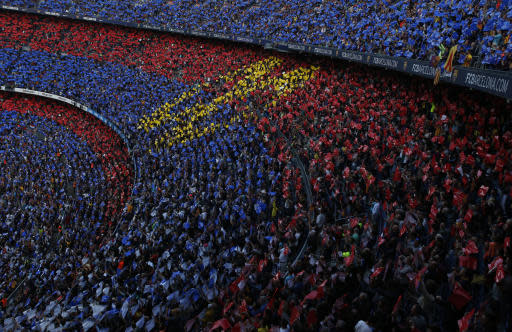 FC Barcelona's supporters pay tribute to Barcelona's Andres Iniesta prior of the Spanish La Liga soccer match between FC Barcelona and Real Sociedad at the Camp Nou stadium in Barcelona, Spain, Sunday, May 20, 2018. Iniesta announced last month he would leave Barcelona after 16 seasons. (AP Photo/Manu Fernandez)
