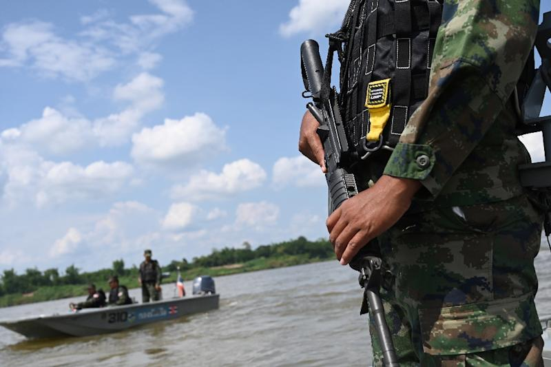An armed Thai navy personnel patrols along the Mekong river in Nakhon Phanom province, where drug gangs ship meth from Laos to Thailand (AFP Photo/Aidan JONES)