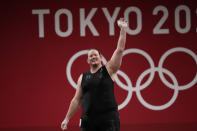 Laurel Hubbard of New Zealand waves after a lift, in the women's +87kg weightlifting event at the 2020 Summer Olympics, Monday, Aug. 2, 2021, in Tokyo, Japan. (AP Photo/Luca Bruno)