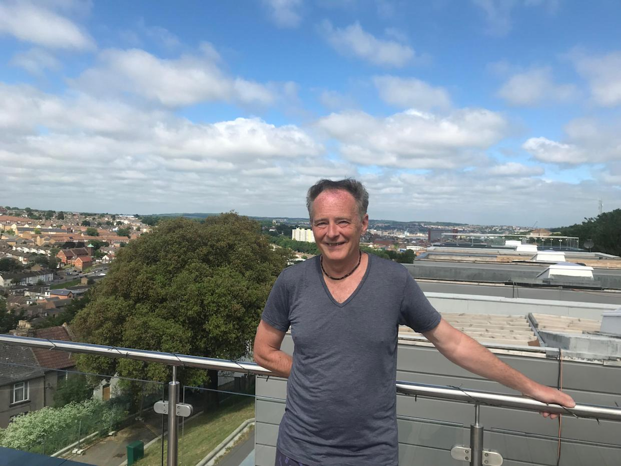 Mark Phillips overlooking the estate in Chatham, Kent. (SWNS)