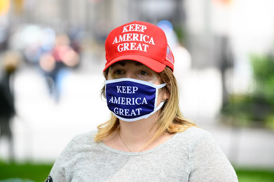 """A person wears a """"Keep America Great"""" protective face mask during the coronavirus pandemic on May 24, 2020 in New York City. (Photo by Noam Galai/Getty Images)"""