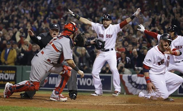 St. Louis Cardinals catcher Yadier Molina looks back as home plate umpire Adam Wainwright call Boston Red Sox's Jonny Gomes safe on a three run RBI double by Shane Victorino during the third inning of Game 6 of baseball's World Series Wednesday, Oct. 30, 2013, in Boston. At center is Jacoby Ellsbury. (AP Photo/Matt Slocum)