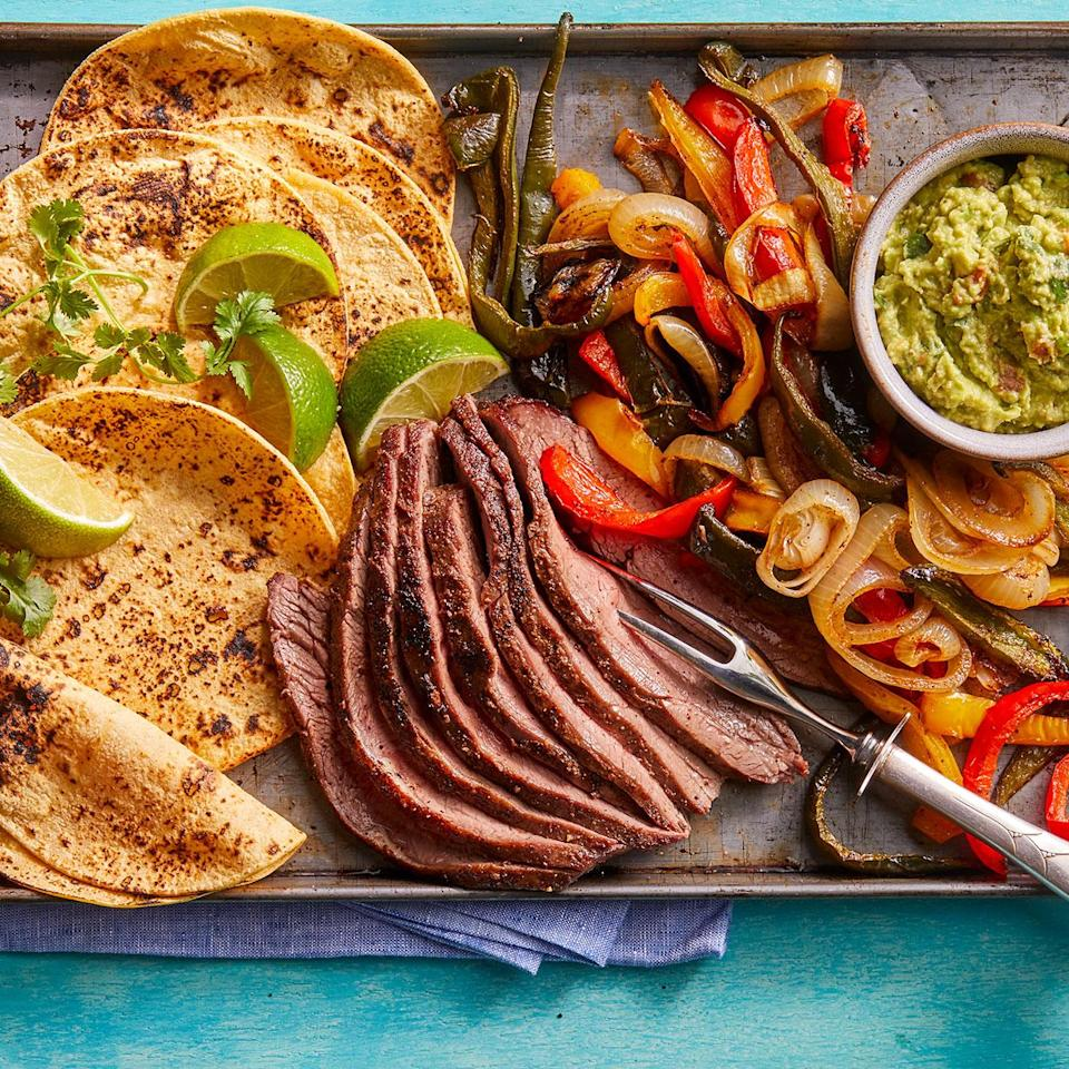 "<p>These flank steak fajitas make for a tasty, healthy dinner in a pinch. Preheated sheet pans sizzle the meat and vegetables just like in a skillet, but with a whole lot more hands-off time. <a href=""http://www.eatingwell.com/recipe/279034/sheet-pan-steak-fajitas/"" rel=""nofollow noopener"" target=""_blank"" data-ylk=""slk:View recipe"" class=""link rapid-noclick-resp""> View recipe </a></p>"