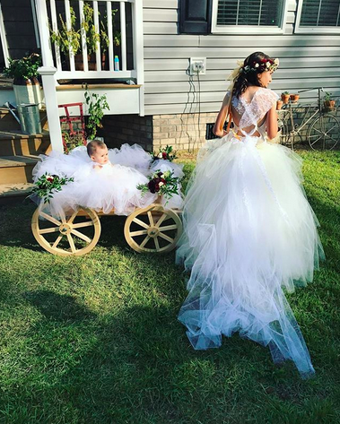 "<p>The reality star's daughter with Eason, Ensley, who was born in January, was too young to walk down the aisle herself, so the little flower girl had a special ride. ""The flowers girls killed it,"" reported Evans. (Photo: <a rel=""nofollow"" href=""https://www.instagram.com/p/BZdhPxRgvfG/?hl=en&taken-by=j_evans1219"">Jenelle Evans via Instagram</a>)<br /><br /></p>"