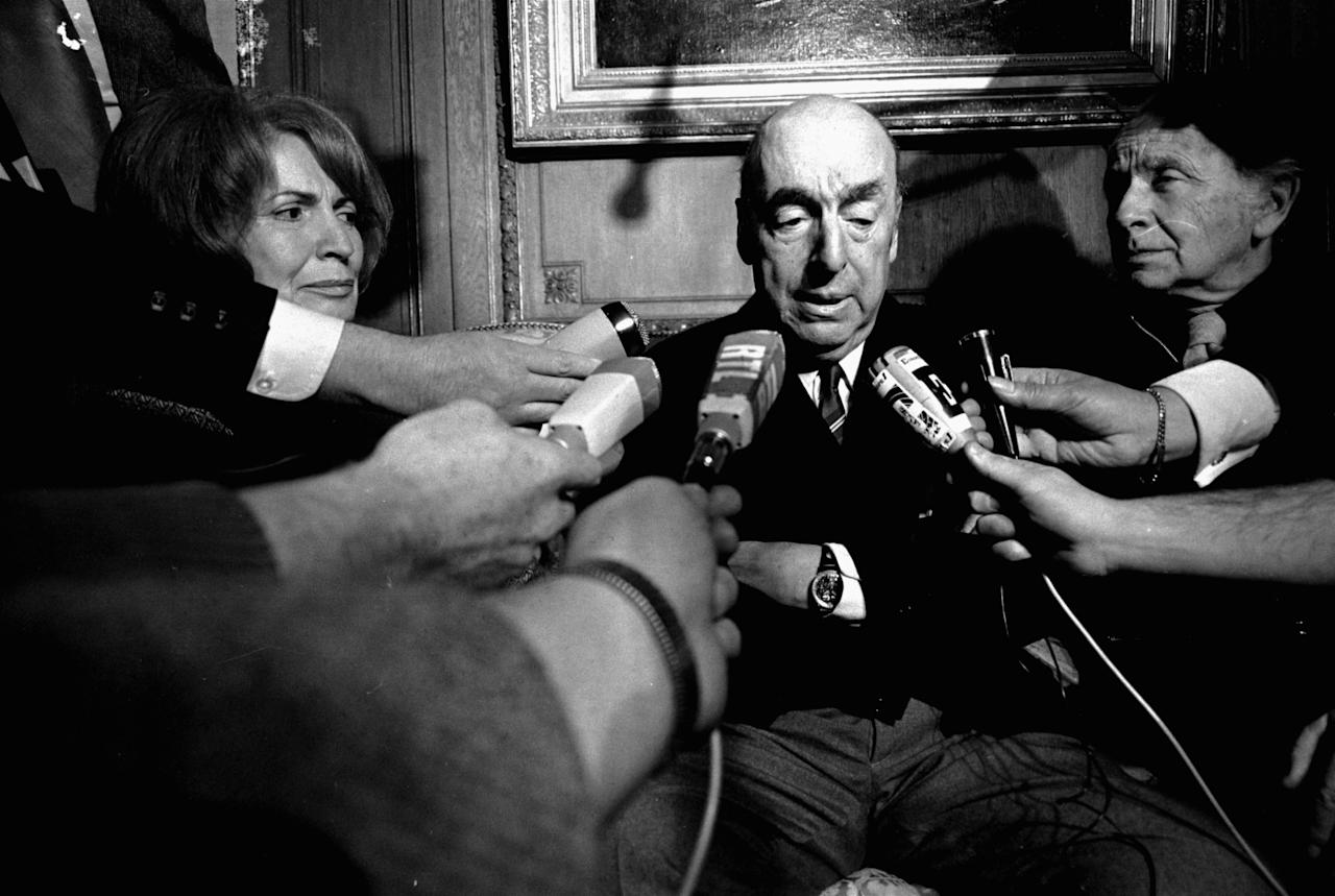 <p> FILE - This Oct. 21, 1971 file photo shows Pablo Neruda, poet and then Chilean ambassador to France, talking with reporters in Paris after being named the 1971 Nobel Prize for Literature. National and foreign experts announced Friday, Oct. 20, 2017, that the Nobel Prize-winning poet did not die of cancer, rejecting the official version. (AP Photo/Laurent Rebours, File) </p>