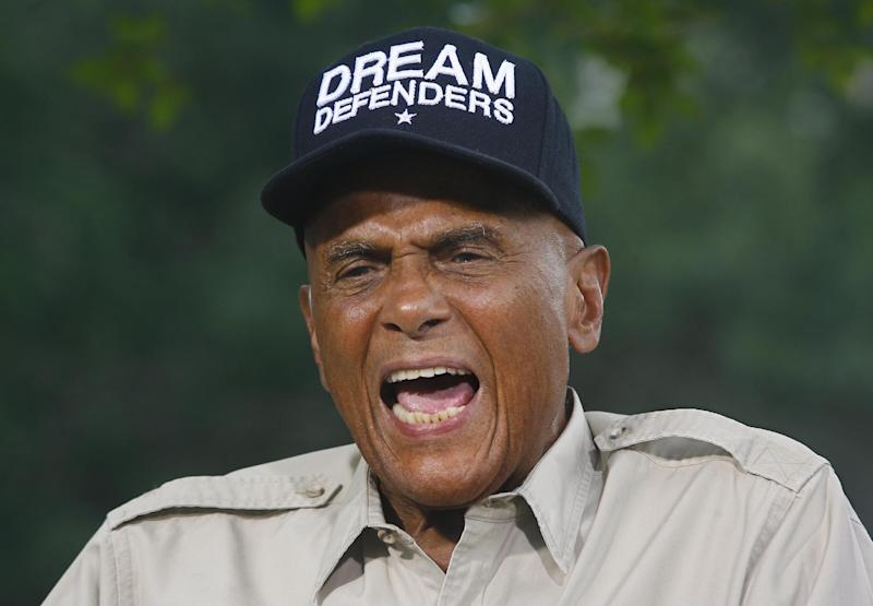 American singer, songwriter, actor and social activist Harry Belafonte, Jr. conducts a network interview Friday July 26, 2013 outside the Florida Capitol in Tallahassee, Fla. Dream Defenders were later joined by Belafonte, Jr. as they went into their 11th day of a sit-in of Florida Gov. Rick Scott's office. The sit-in is their response to the 'not guilty' verdict in the trial of George Zimmerman, the Florida neighborhood watch volunteer who fatally shot Trayvon Martin. They are continuing to demand Scott call a special session. (AP Photo/Phil Sears)