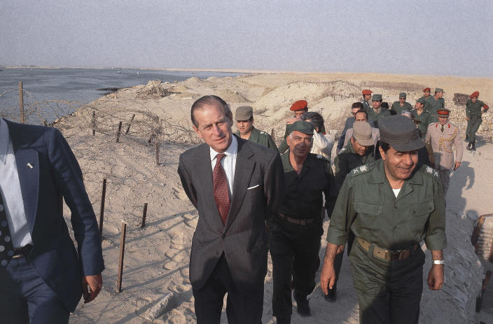 FILE - In this 1981 file photo, Britain's Prince Philip visits the remnants of the Bar-Lev line in Egypt in 1981. Buckingham Palace officials say Prince Philip, the husband of Queen Elizabeth II, has died, it was announced on Friday, April 9, 2021. He was 99. Philip spent a month in hospital earlier this year before being released on March 16 to return to Windsor Castle. Philip, also known as the Duke of Edinburgh, married Elizabeth in 1947 and was the longest-serving consort in British history. (AP Photo/Bill Foley, File)