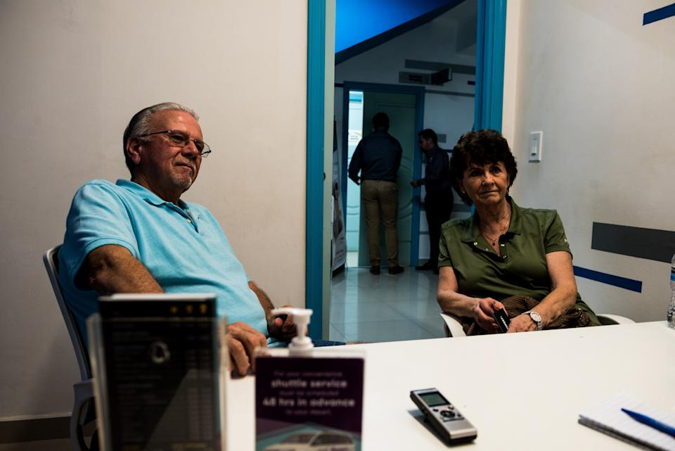 Dan, 77, and Donette Brower, 75, of Spokane, Washington, sit in the consultation room before getting new X-rays and routine cleanings at Sani Dental Group in Los Algodones, Baja California, Mexico, on Oct. 23, 2019. (Photo: Ash Ponders for HuffPost)