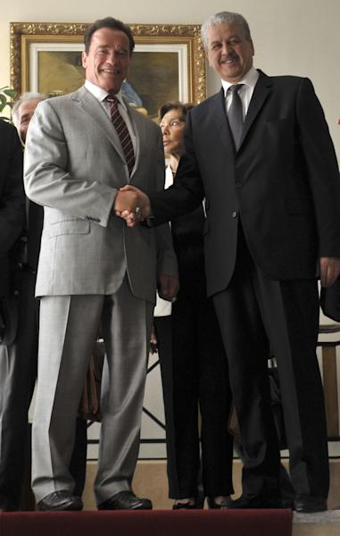 Algerian Prime Minister Abdelmalek Sellal, right, shakes hands with former California Governor Arnold Schwarzenegger, now president of NGO R20. Schwarzenegger founded R20, a coalition of partners led by regional governments that work to promote and implement projects that are designed to produce local economic and environmental benefits in the form of reduced energy consumption and greenhouse gas emissions. The R20 will open an office in Algiers. (AP Photo/Anis Belghoul)