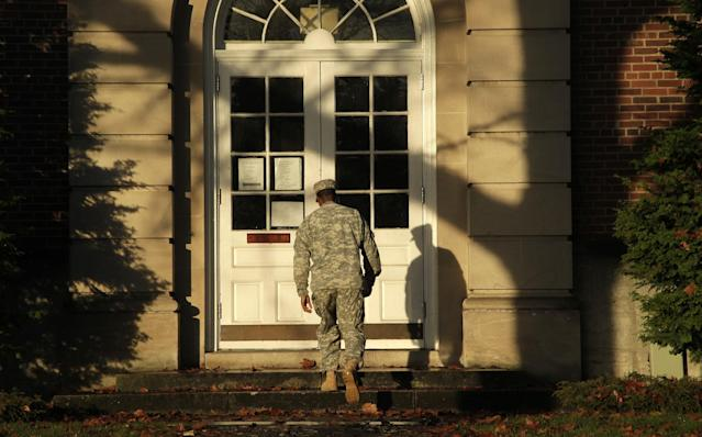 A soldier walks outside the building housing a military courtroom on Joint Base Lewis McChord in Washington state, where a preliminary hearing was expected to conclude Tuesday Nov. 13, 2012, for U.S. Army Staff Sgt. Robert Bales. Bales is accused of 16 counts of premeditated murder and six counts of attempted murder for a pre-dawn attack on two villages in Kandahar Province in Afghanistan last March. (AP Photo/Ted S. Warren)