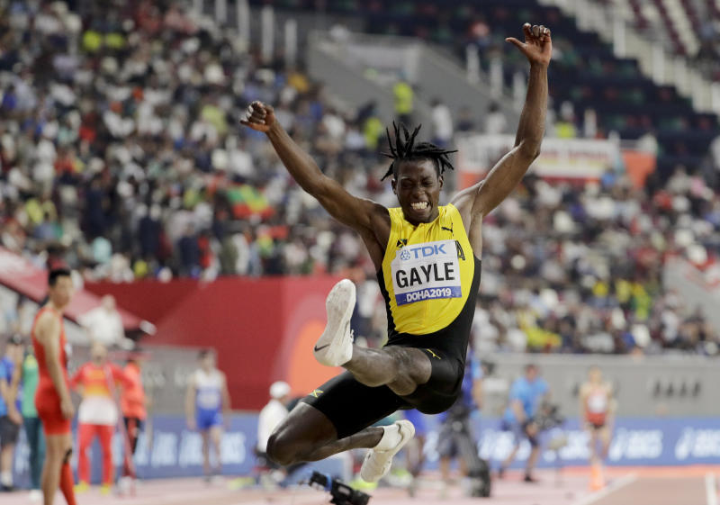 Tajay Gayle, of Jamaica, competes in the men's long jump final at the World Athletics Championships in Doha, Qatar, Saturday, Sept. 28, 2019. (AP Photo/Hassan Ammar)