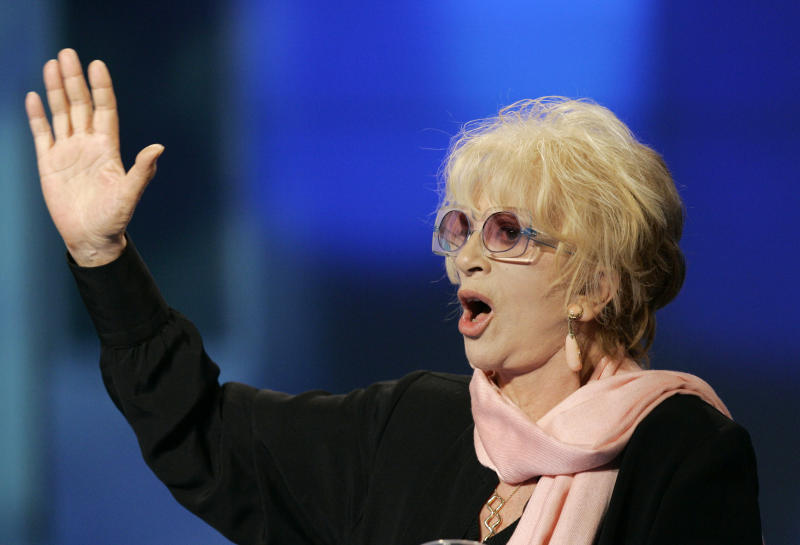 """FILE - In this May 9, 2009 file photo Franca Rame gestures during the Italian State RAI TV program """"Che Tempo che Fa"""", in Milan. Franca Rame has died in Milan, Wednesday, May 29, 2013. She was 84. (AP Photo/Antonio Calanni, File)"""