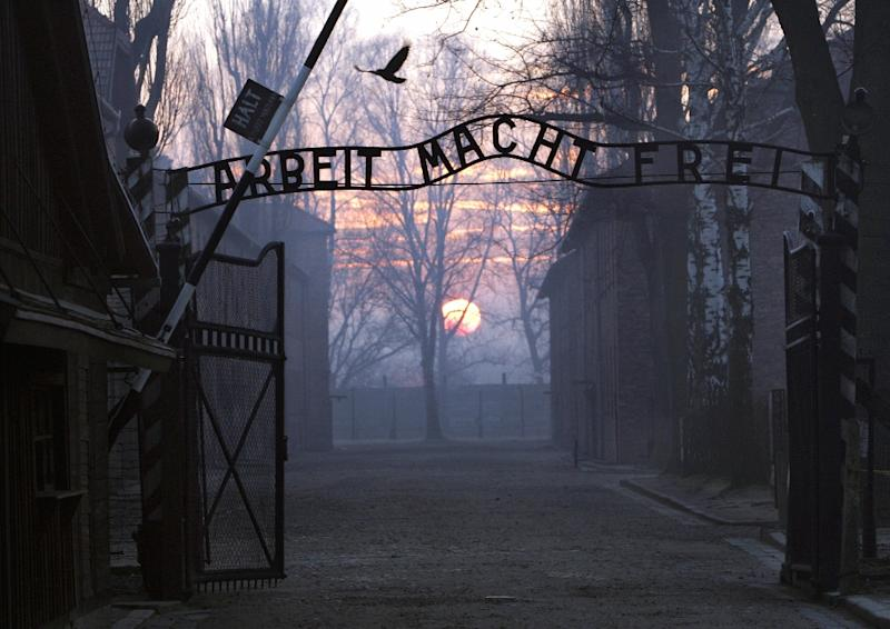 "Main gate entering the Nazi Auschwitz death camp at sunrise with the infamous sign reading ""Arbeit macht frei"" (Work sets you free) (AFP Photo/Janek Skarzynski)"
