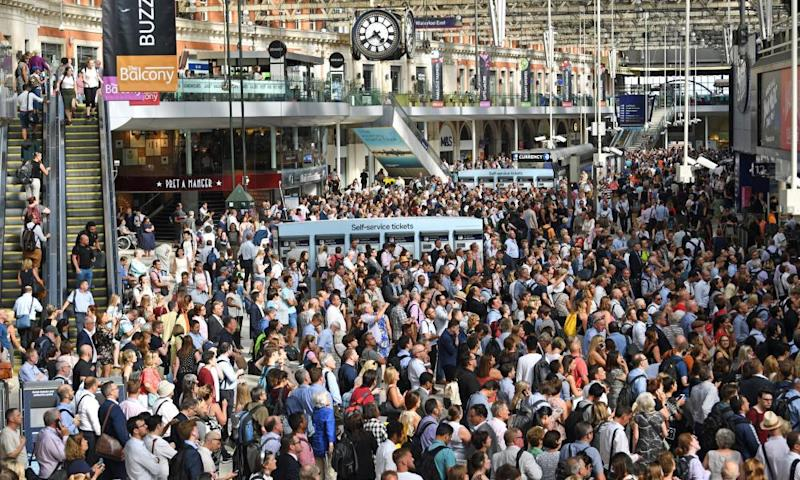 Slow train to nowhere: commuters at London's Waterloo station.