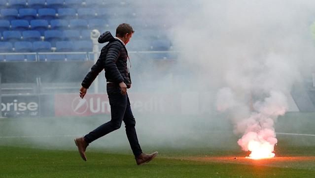 Soccer Football - Europa League Final - Olympique de Marseille vs Atletico Madrid - Groupama Stadium, Lyon, France - May 16, 2018 Staff remove a flare that was thrown on the pitch from outside the stadium before the match Action Images via Reuters/John Sibley
