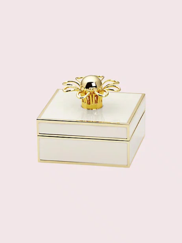 """<p><strong>kate spade</strong></p><p>katespade.com</p><p><strong>$35.00</strong></p><p><a href=""""https://go.redirectingat.com?id=74968X1596630&url=https%3A%2F%2Fwww.katespade.com%2Fproducts%2Fkeaton-jewelry-box%2FL871930.html&sref=https%3A%2F%2Fwww.housebeautiful.com%2Fentertaining%2Fholidays-celebrations%2Fg4092%2Fvalentines-day-gifts-for-her%2F"""" rel=""""nofollow noopener"""" target=""""_blank"""" data-ylk=""""slk:BUY NOW"""" class=""""link rapid-noclick-resp"""">BUY NOW</a></p><p>If she doesn't already own a jewelry box, she'll appreciate this pretty flower-topped one. </p>"""