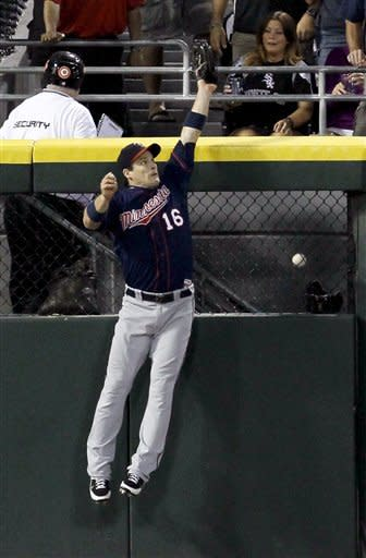 Minnesota Twins left fielder Josh Willingham is unable to catch the home run by Chicago White Sox's Paul Konerko during the fifth inning of a baseball game, Tuesday, July 24, 2012, in Chicago. (AP Photo/Charles Rex Arbogast)