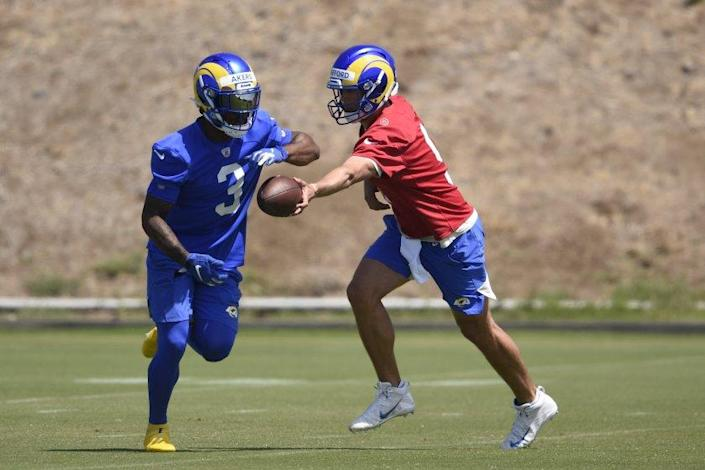 Los Angeles Rams' Matthew Stafford, right, runs a drill with Cam Akers during NFL football practice in Thousand Oaks, Calif., Thursday, May 27, 2021. (AP Photo/Kelvin Kuo)