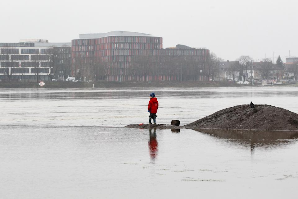 A child seen looking at the Waal river flooding. Heavy rainfall and melting snow have caused flooding and landslides in Germany. Water levels of major rivers have reached their highest levels. (Photo by Osama Faisal / SOPA Images/Sipa USA)