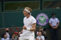 Canada's Denis Shapovalov celebrates winning a point against Serbia's Novak Djokovic during the men's singles semifinals match on day eleven of the Wimbledon Tennis Championships in London, Friday, July 9, 2021. (AP Photo/Alberto Pezzali)